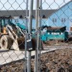 Master Lock 6400LJENT on Construction Gate Exterior